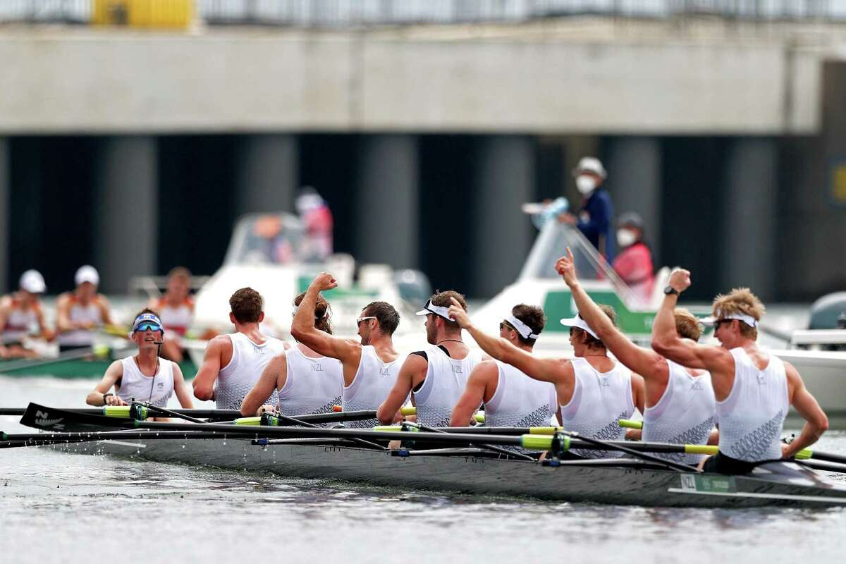 TOKYO, JAPAN - JULY 30: Sam Bosworth, Matt Macdonald, Shaun Kirkham, Phillip Wilson, Daniel Williamson, Michael Brake, Tom Murray, Hamish Bond and Thomas Mackintosh of Team New Zealand celebrate winning the gold medal during the Men's Eight Final A on day seven of the Tokyo 2020 Olympic Games at Sea Forest Waterway on July 30, 2021 in Tokyo, Japan. (Photo by Naomi Baker/Getty Images)