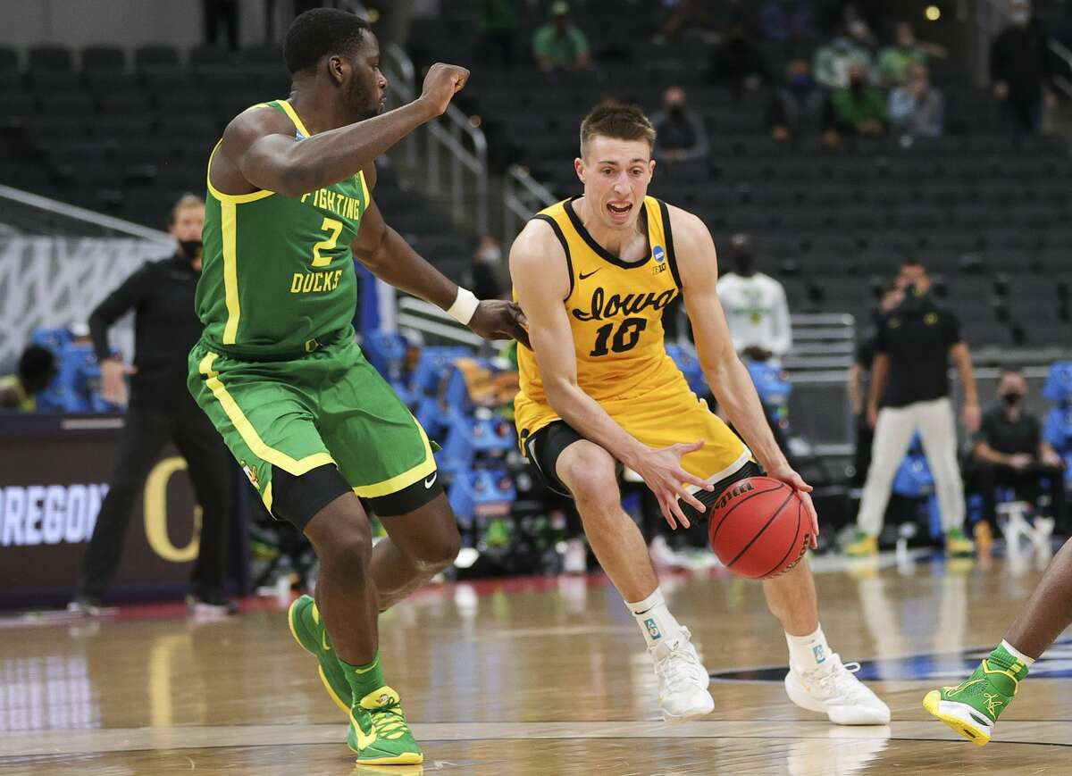 Joe Wieskamp #10 of the Iowa Hawkeyes is defended by Eugene Omoruyiof the Oregon Ducks in the second round game of the 2021 NCAA Men's Basketball Tournament at Bankers Life Fieldhouse on March 22, 2021 in Indianapolis.