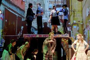"""The high school cast of """"Urinetown :  The Musical"""" run through a dress reheasrsal for the finale of this summer's Beaumont Community Players KIDmunity workshop performances at The Betty Greenberg Center for Performing Arts Wednesday.  Musical theater lovers and those with a taste for cynical humor heavy on the camp and references to musicals of note will appreciate this offbeat performance where young thespians truly shine as actors, singers and dancers. It's been two years since area youth have gotten to study with local professionals and show off the fruits of their onstage labors, but they have embraced this summer's theater opportunity with all the zest of someone sitting down to a smorgasboard after a year's-long fast. They're relishing every moment of their time onstage, and it shows.  Photo made Wednesday, July 28, 2021 Kim Brent/The Enterprise"""