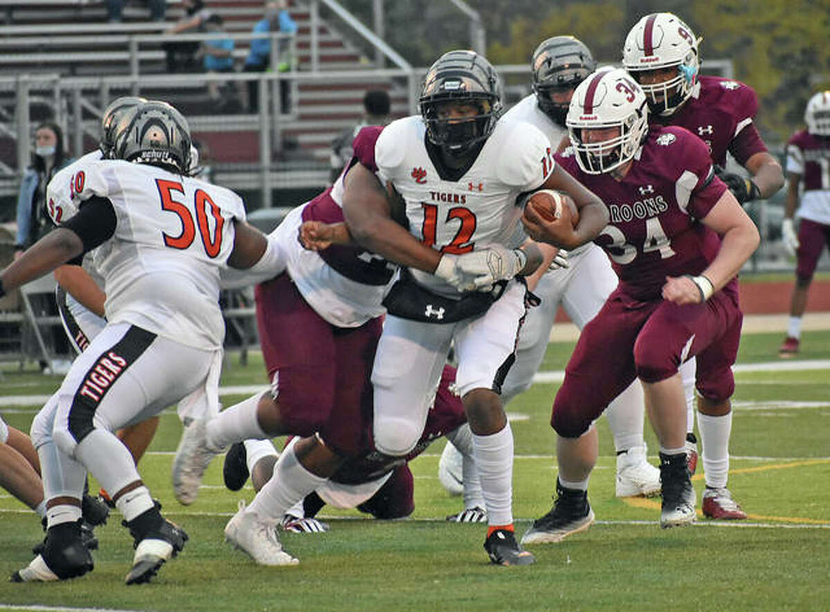 Junior James Distaso-Hutchins tries to break a tackle during a Week 4 game at Belleville West last season.