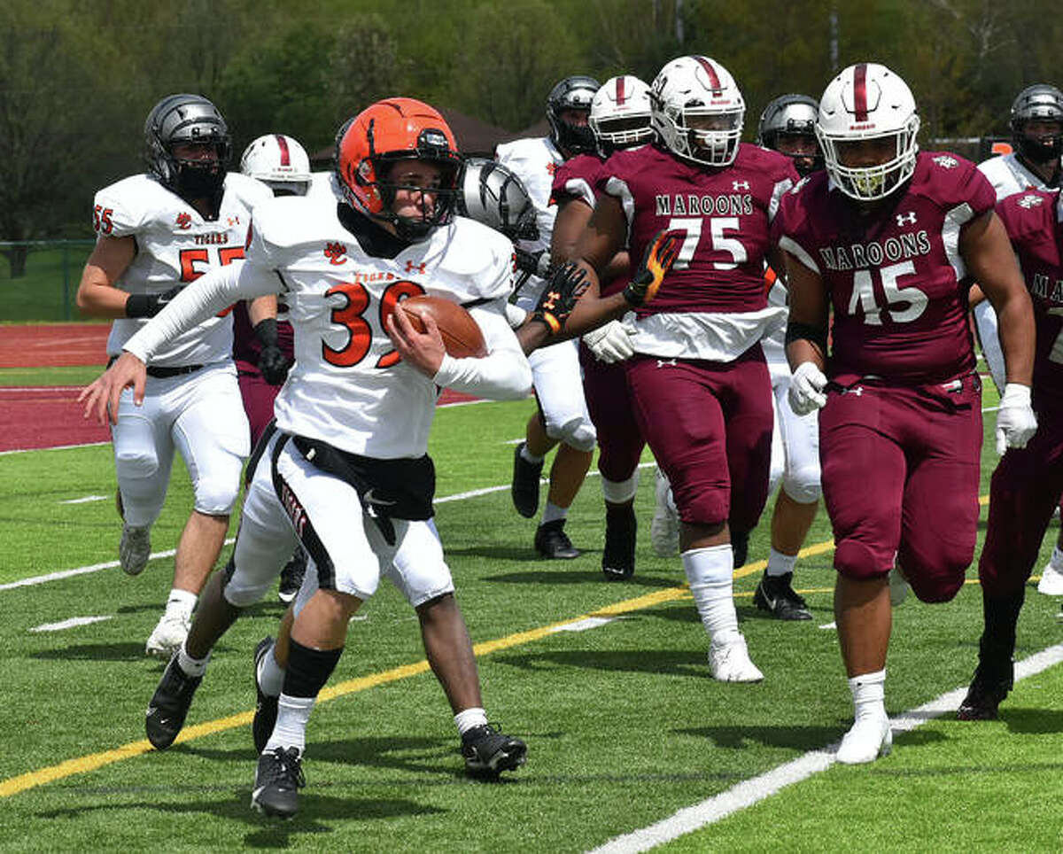 Sophomore Jake Curry looks for running room on the outside against Belleville West last season.