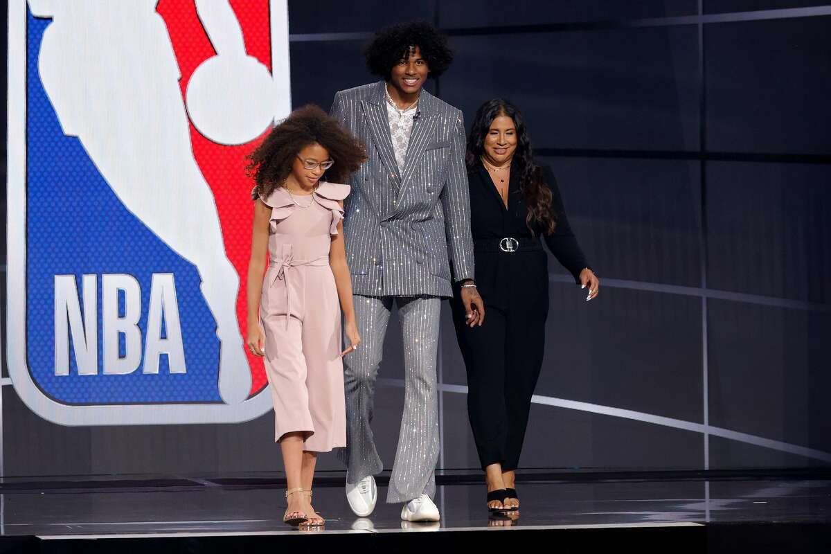 Jalen Green walks across the stage during the 2021 NBA Draft at the Barclays Center on July 29, 2021 in New York City.