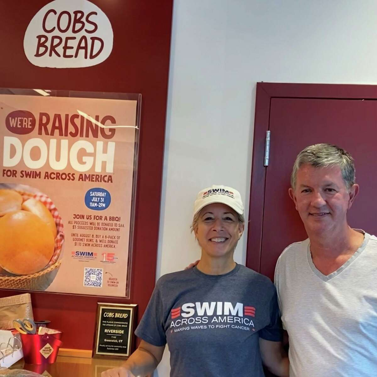 Nancy Carr, co-chair of Swim Across America Fairfield County, with Rob Hyden, owner of the COBS Bread Riverside location. COBS Bread is raising dough for the nonprofit to support cancer research.