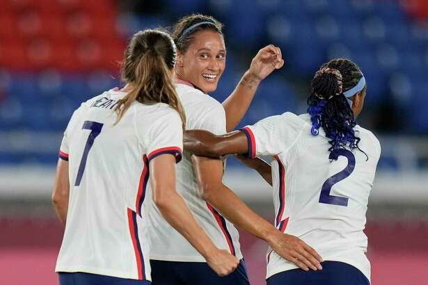 United States' Lynn Williams, center, celebrates with teammates after scoring a goal against Netherlands during a women's quarterfinal soccer match at the 2020 Summer Olympics, Friday, July 30, 2021, in Yokohama, Japan.