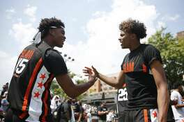 Josh Christopher (45) of Team Zion high fives Jalen Green (14) prior to the SLAM Summer Classic 2019 at Dyckman Park on August 18, 2019 in New York City. (Photo by Michael Reaves/Getty Images)
