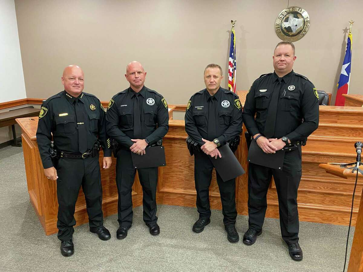 From left, Fort Bend County Precinct 3 Constable Chad Norvell honors Deputies Bryan Steffen, Gregory Markovsky and Roger Castillo for their actions in thwarting a potential teen suicide jumper at a ceremony on July 28, 2021.