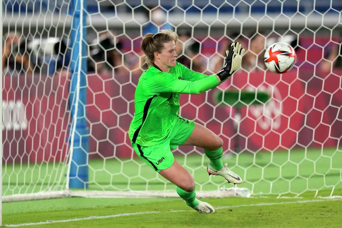 United States' goalkeeper Alyssa Naeher stops a ball in a the penalty shootout against Netherlands during a women's quarterfinal soccer match at the 2020 Summer Olympics, Friday, July 30, 2021, in Yokohama, Japan. (AP Photo/Silvia Izquierdo)