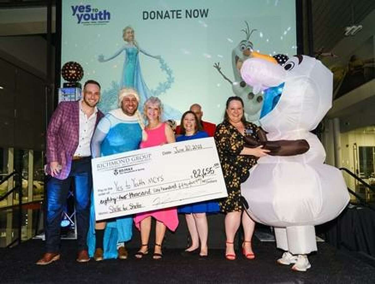 Pictured from left are: Hunter Strong, emcee; Zach Richmond of Richmond Realty RE/MAX The Woodlands & Spring; Dannette Suding, Penny Wilson, and Mindy Reynolds of YES to YOUTH; and Rachel Richmond (in Frozen's Olaf costume) of Richmond Realty RE/MAX The Woodlands and Spring.