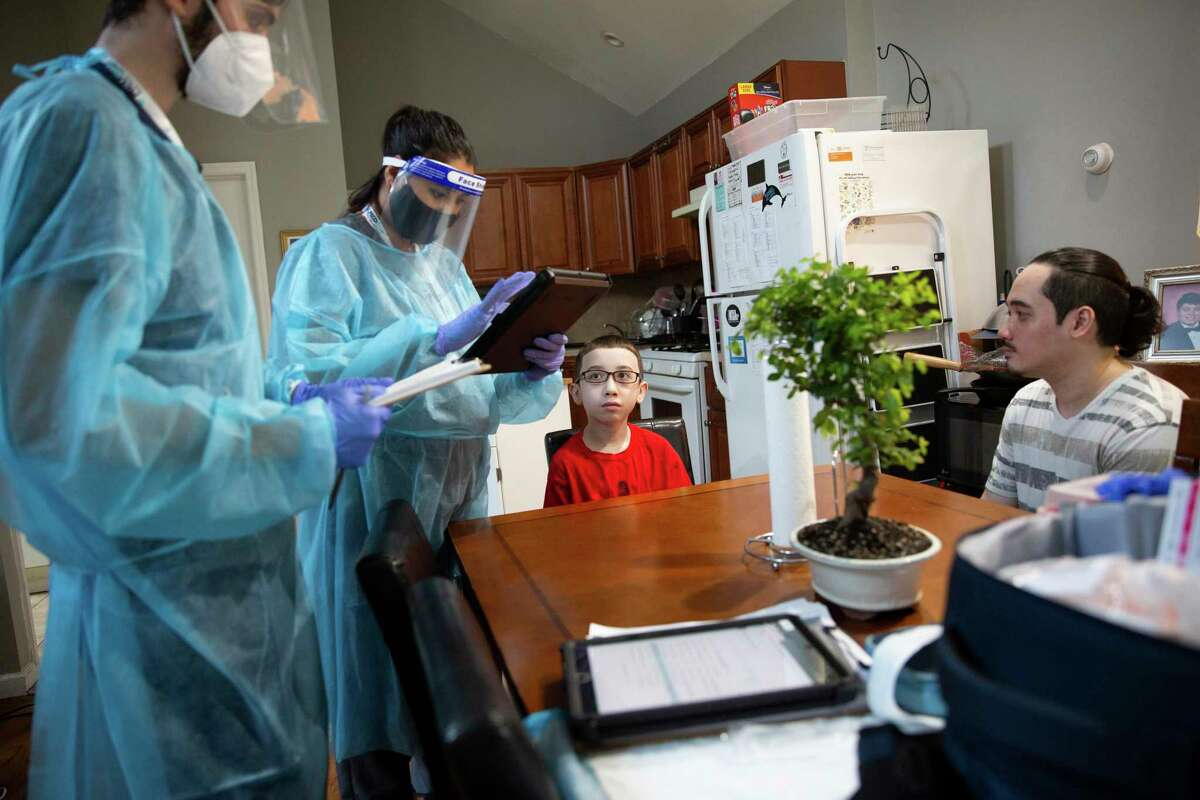 Eli Nazario, 13, who has serious allergies and asthma, receives the second dose of the Pfizer coronavirus vaccine during an in-home visit on Staten Island, July 16, 2021. Staten Island has been a hot spot that presaged a broader uptick in coronavirus cases, and for weeks, several ZIP codes in the area had among the most cases in the city. (Olga Ginzburg/The New York Times)