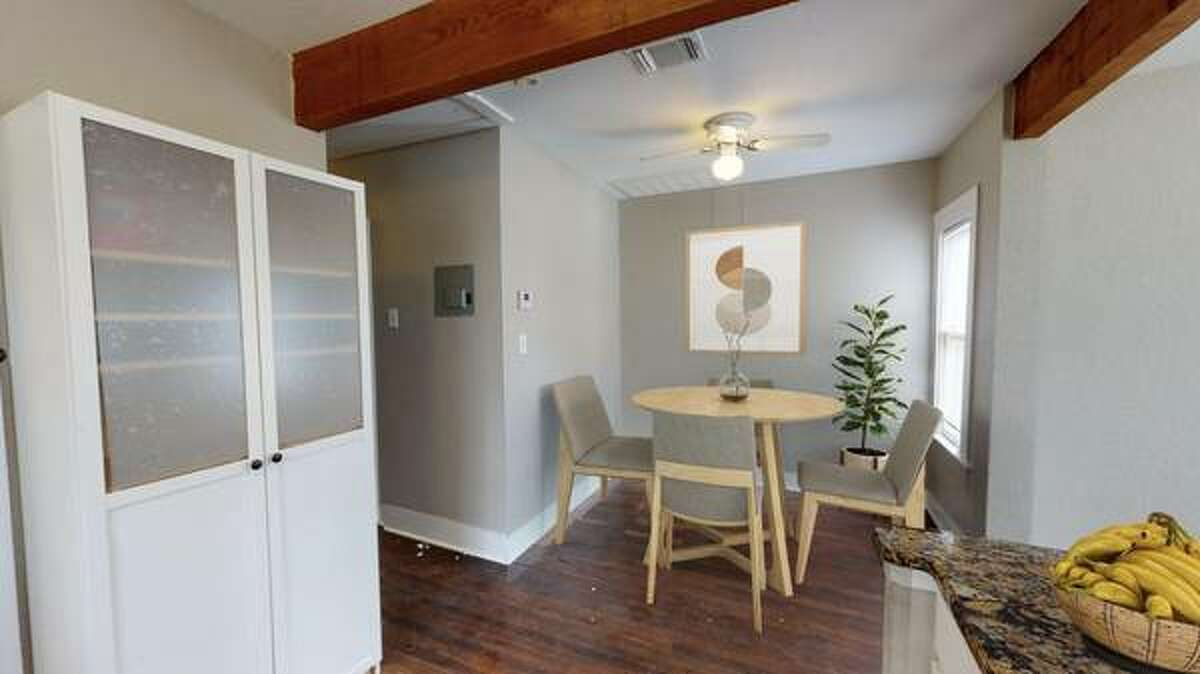 The cozy dining nook sits across from the kitchen.