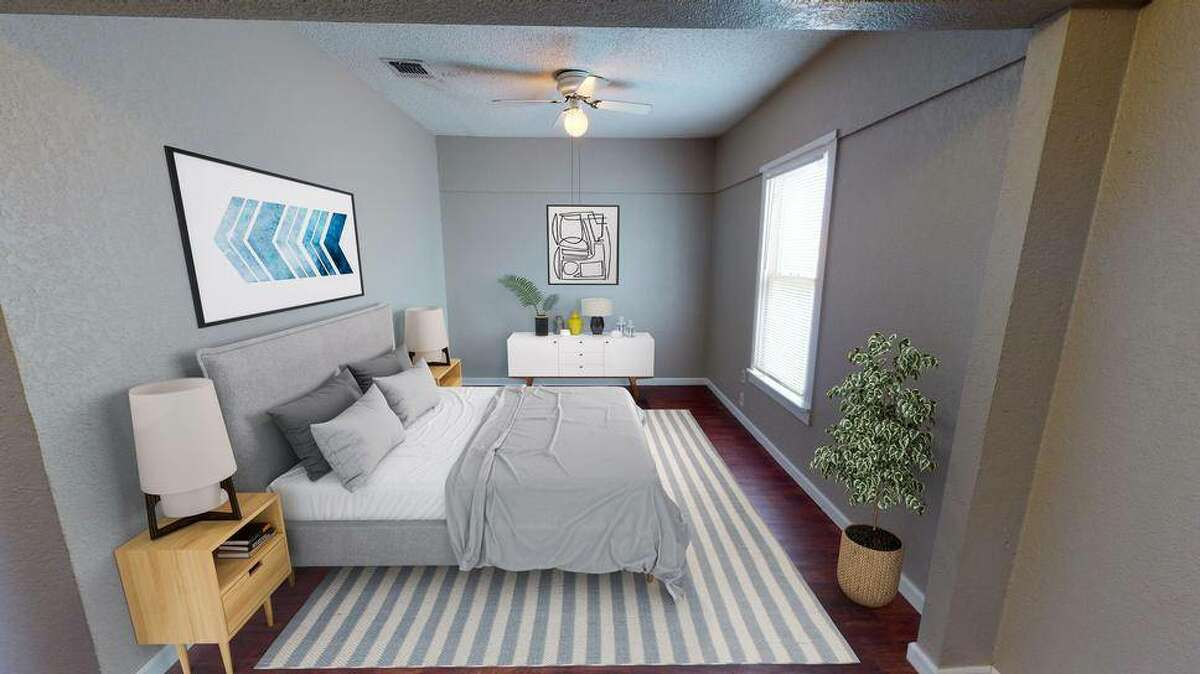 One bedroom offers up plenty of space.