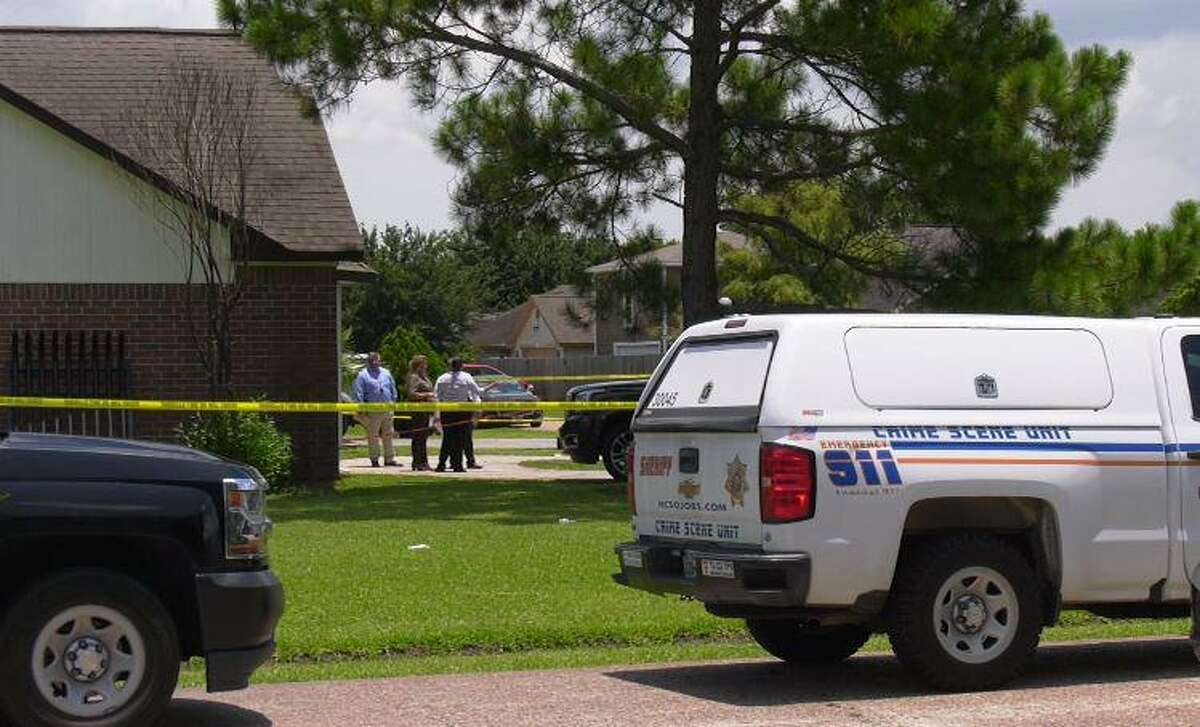Harris County Sheriff's Office authorities investigate a fatal shooting in the 2100 block of Orange Blossom Lane on July 2, 2021.