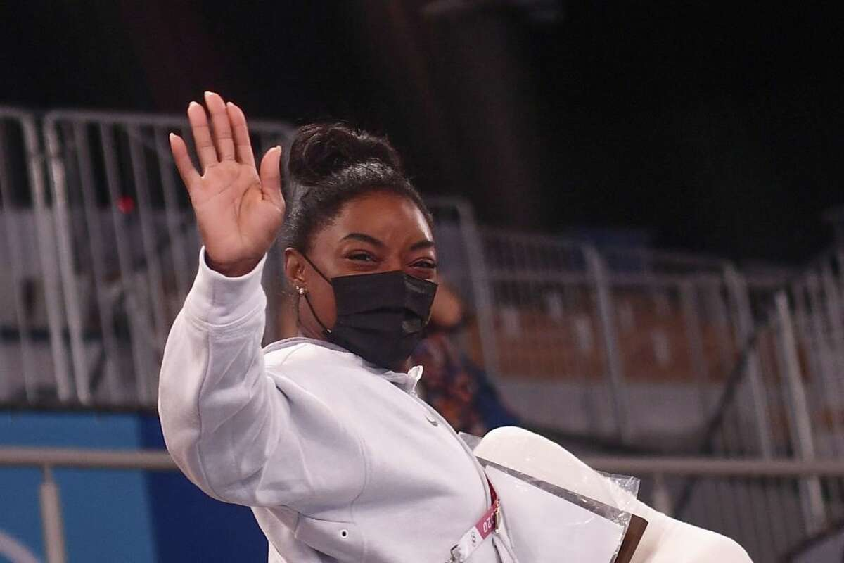 USA's Simone Biles waves after the artistic gymnastics women's all-around final during the Tokyo 2020 Olympic Games at the Ariake Gymnastics Centre in Tokyo on July 29, 2021.