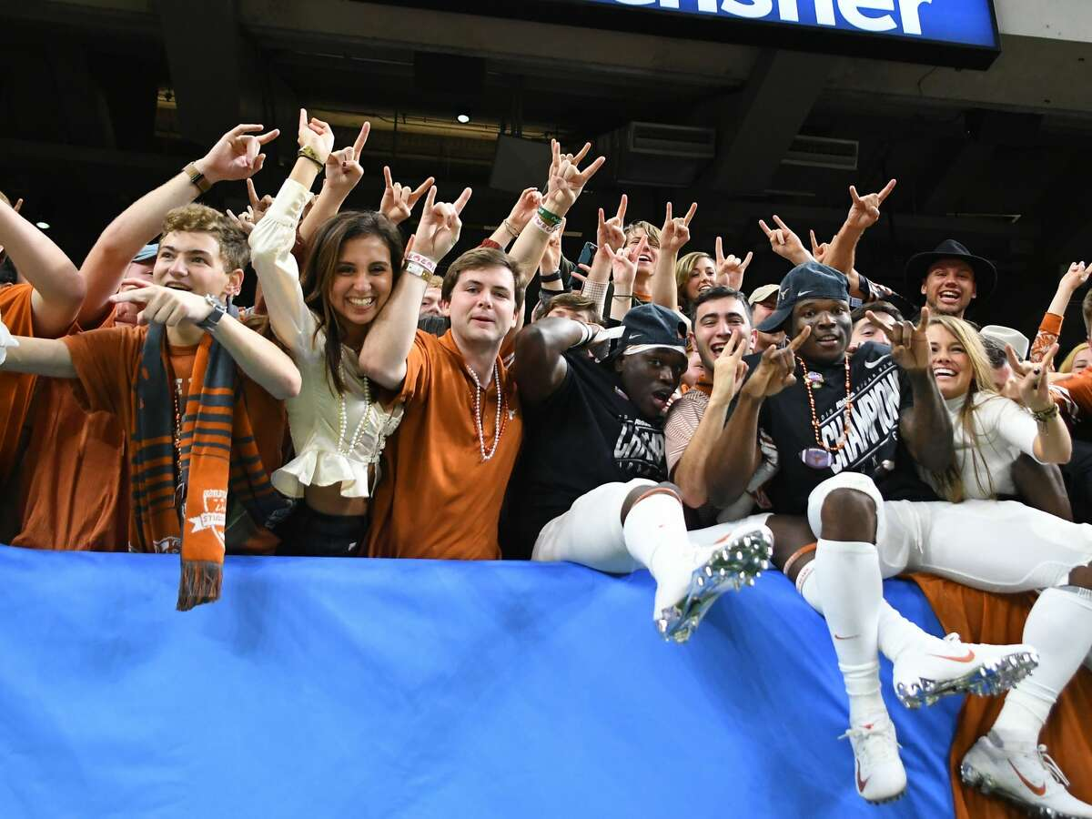 """Texas Longhorns fans and players celebrate a win over SEC power Georgia in the 2019 Super Bowl. It was just one of many times the Longhorns thought they were """"back."""""""