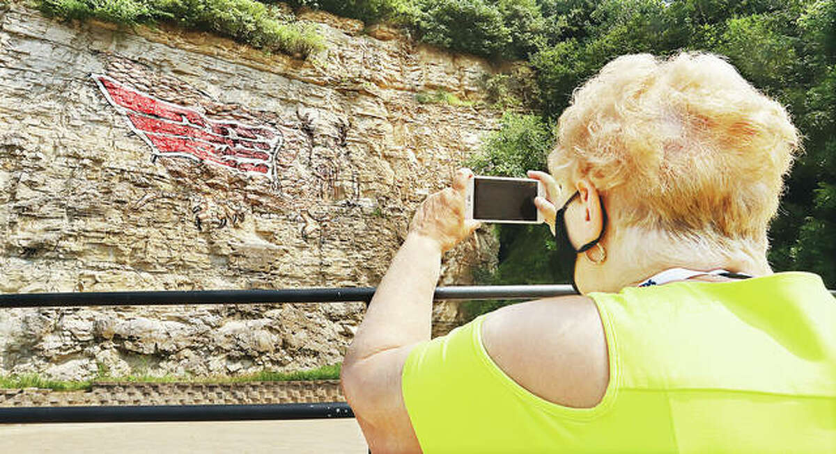 A busload of birdwatchers were taking pictures Tuesday at the Piasa Bird on the Great River Road in Alton. The bus was hitting historic sites around town with passengers from the cruise ship, Queen of the Mississippi, which docked in Alton.