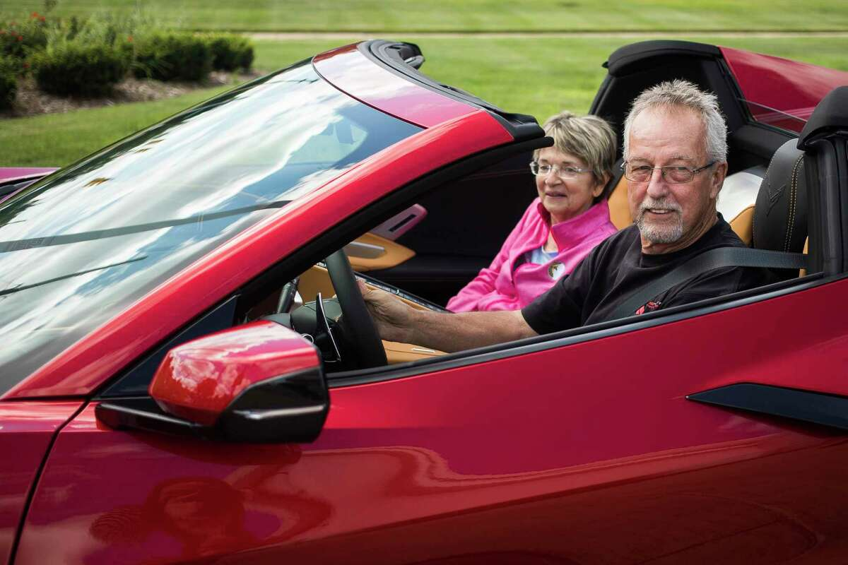 Tom Clark of Sanford, right, and his wife, Cheryl Clark, left, pull out of the parking lot as Tom picks up his 38th Corvette, a new red convertible, from Garber Chevrolet in Midland Fridayafternoon. For more photos, visit www.ourmidland.com. (Katy Kildee/kkildee@mdn.net)