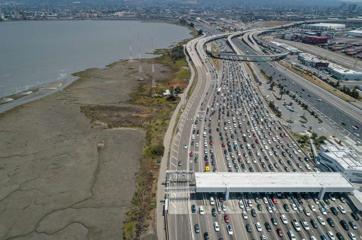 Traffic backs up at the Bay Bridge tollbooths last Sunday. Data shows that weekend traffic has been steadily increasing as the Bay Area reopens from the pandemic.
