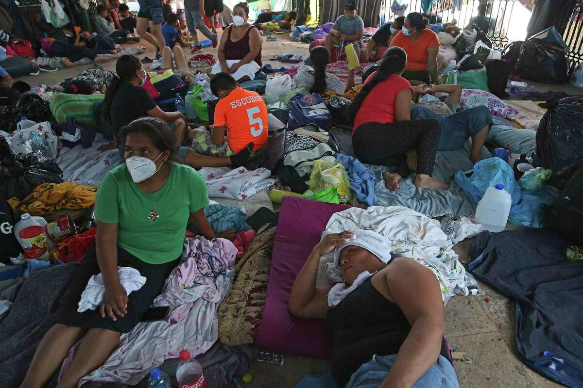 Migrants crowd the Plaza de la Republica bandstand in Reynosa.