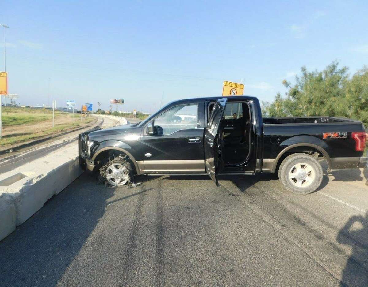 A vehicle is shown with its tire deflated after a spikestrip took it out on Interstate Highway 35 on Friday, July 30, 2021.