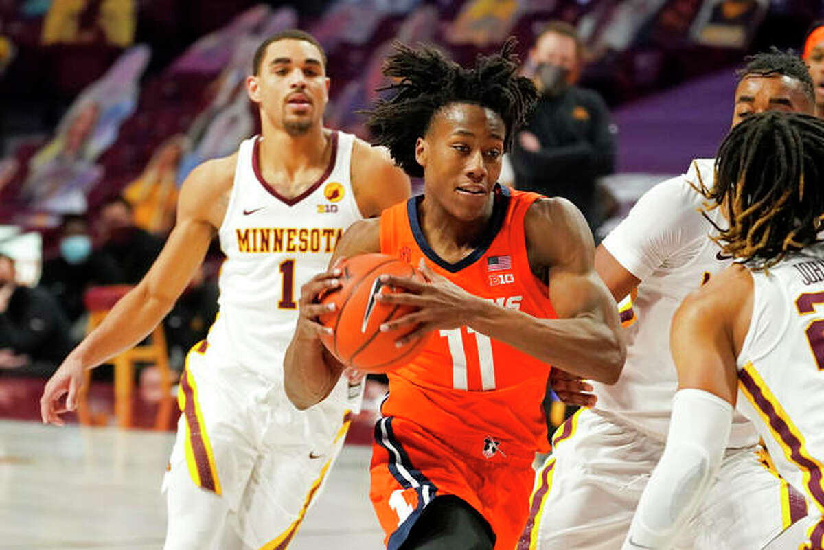 Illinois' Ayo Dosunmu (11) drives during a February Illini game against the University of Minnesota in Minneapolis.