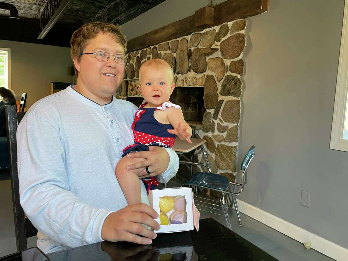 Pictured is Jamie Larson, owner of the Sugar Daddy in Big Rapids, with his co-worker/daughter Charlotte. (Pioneer Photo/ Gena Harris)
