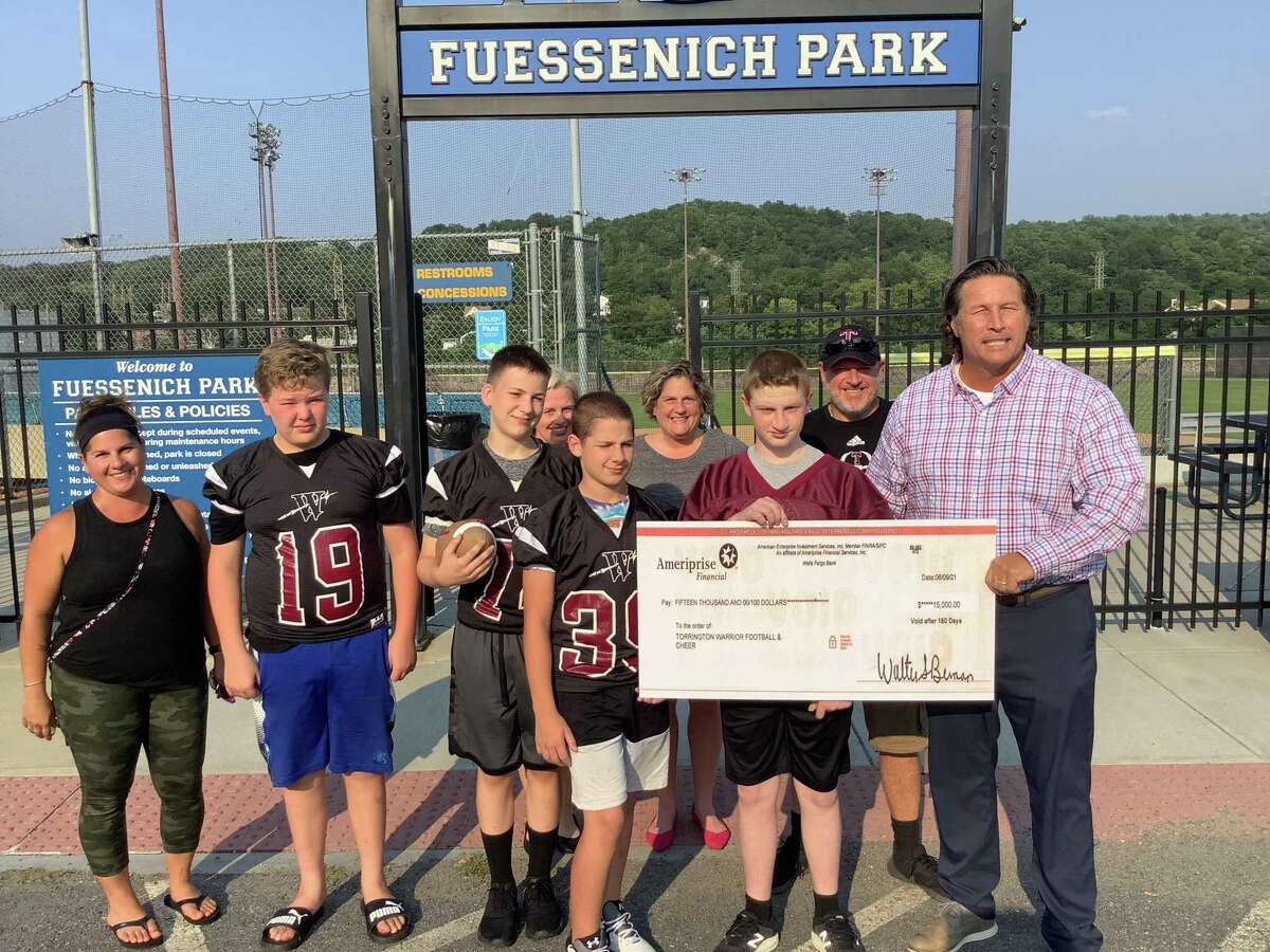At Fuessenich Park July 27, checks for $15,000 each were presented to representatives from American Legion Baseball, the Torrington Warrior Football program, and Torrington Youth Soccer. Jonathon Root, right, with the Warriors, presented the money to each group on behalf of an anonymous donor.