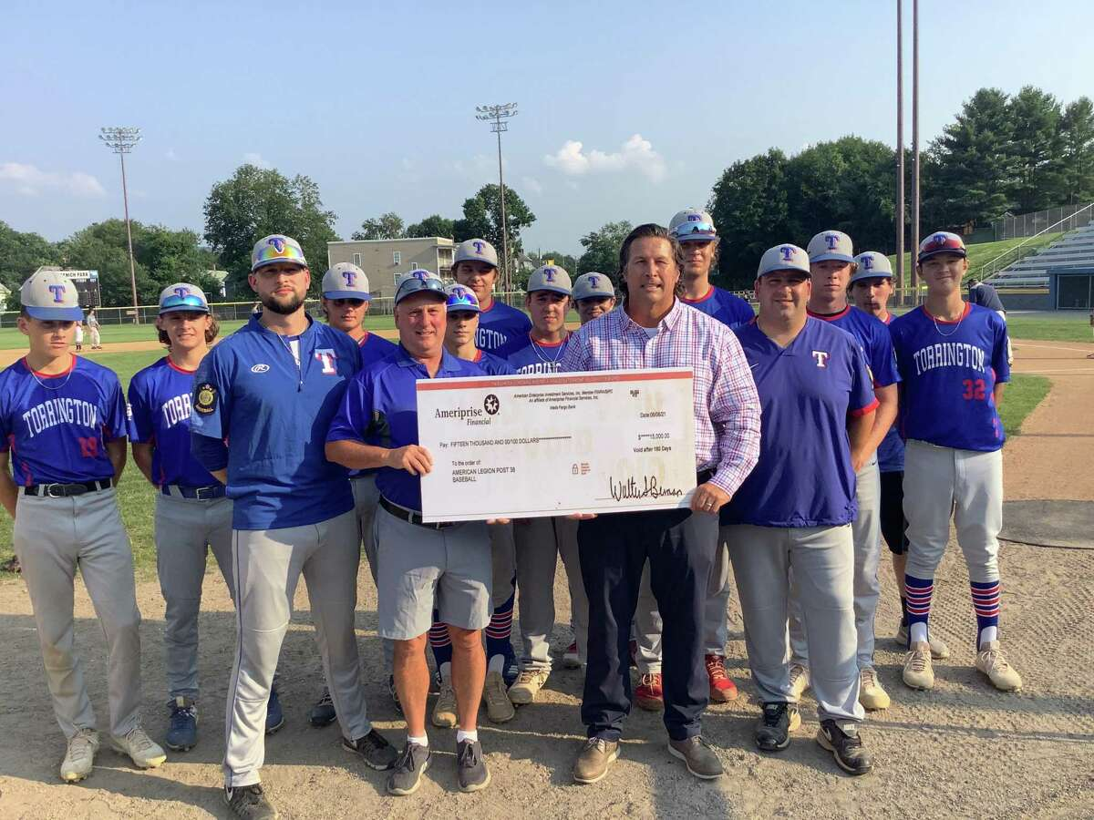 At Fuessenich Park July 27, checks for $15,000 each were presented to representatives from American Legion Baseball, the Torrington Warrior Football program, and Torrington Youth Soccer. Jonathon Root, front right, pictured with American Legion Baseball team members, presented the money to each group on behalf of an anonymous donor.