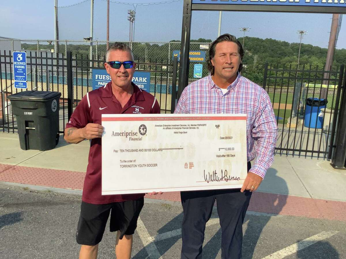 At Fuessenich Park July 27, checks for $15,000 each were presented to representatives from American Legion Baseball, the Torrington Warrior Football program, and Torrington Youth Soccer. Jonathon Root, right, pictured with a representative from Torrington Youth Soccer, presented the money to each group on behalf of an anonymous donor.