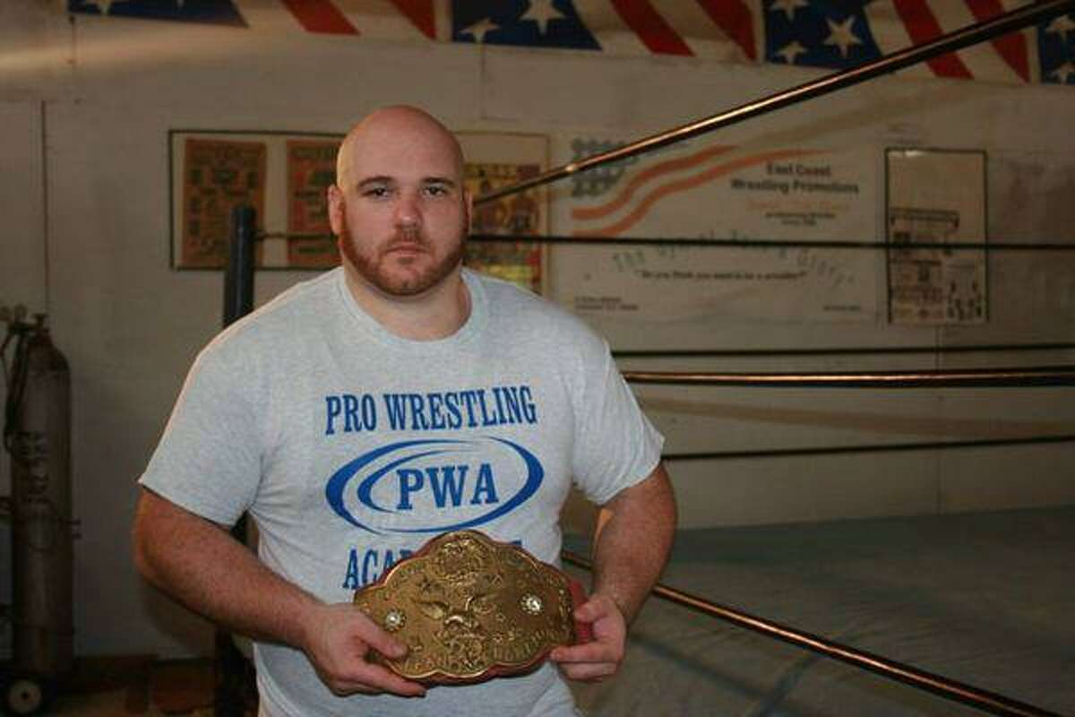 """A new documentary on women's pro wrestling, """"Circle of Champions: the History of Women's Pro Wrestling"""" will soon be wrapped. The film is about former wrestler Angel Orsini who was forced to quit due to a career. The film documents the history through her journey and shows the importance of empowerment through sisterhood. Pictured is filmmaker Christopher Annino with a WWF Womens tag belt."""