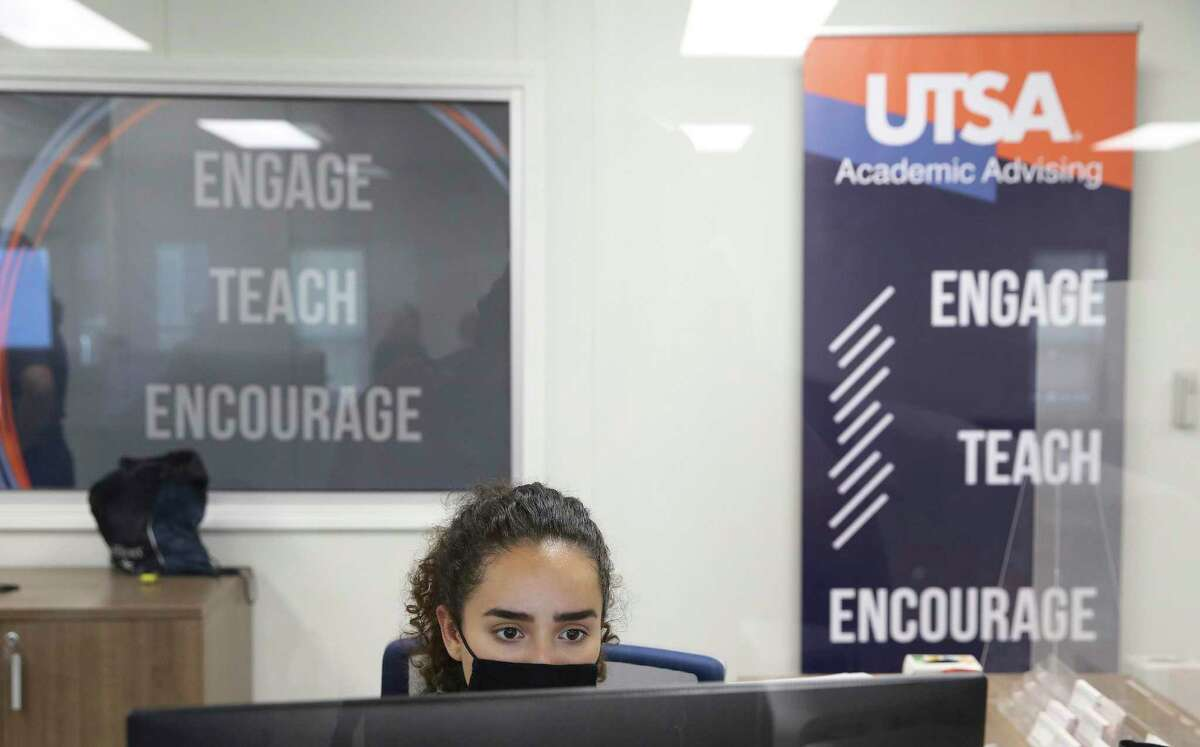 A UTSA staff member is seen Wednesday in the school's new Student Success Center preparing for the start of school. Higher education institutions are increasing resources such as tutoring and advising services to prepare for a freshman class of high school graduates who experienced a year of disruptions and learning losses.