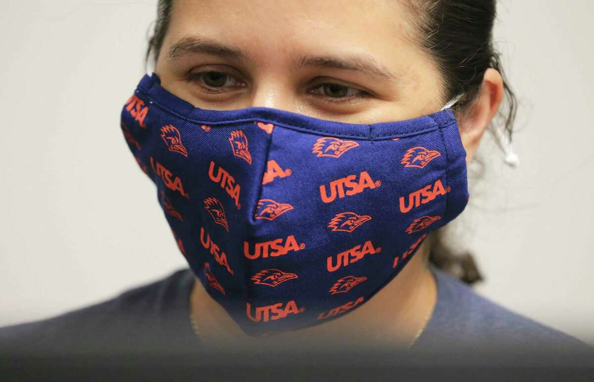 Academic advisor Paula Perilla dons a UTSA mask while working in her office in the school's new Student Success Center on Wednesday.
