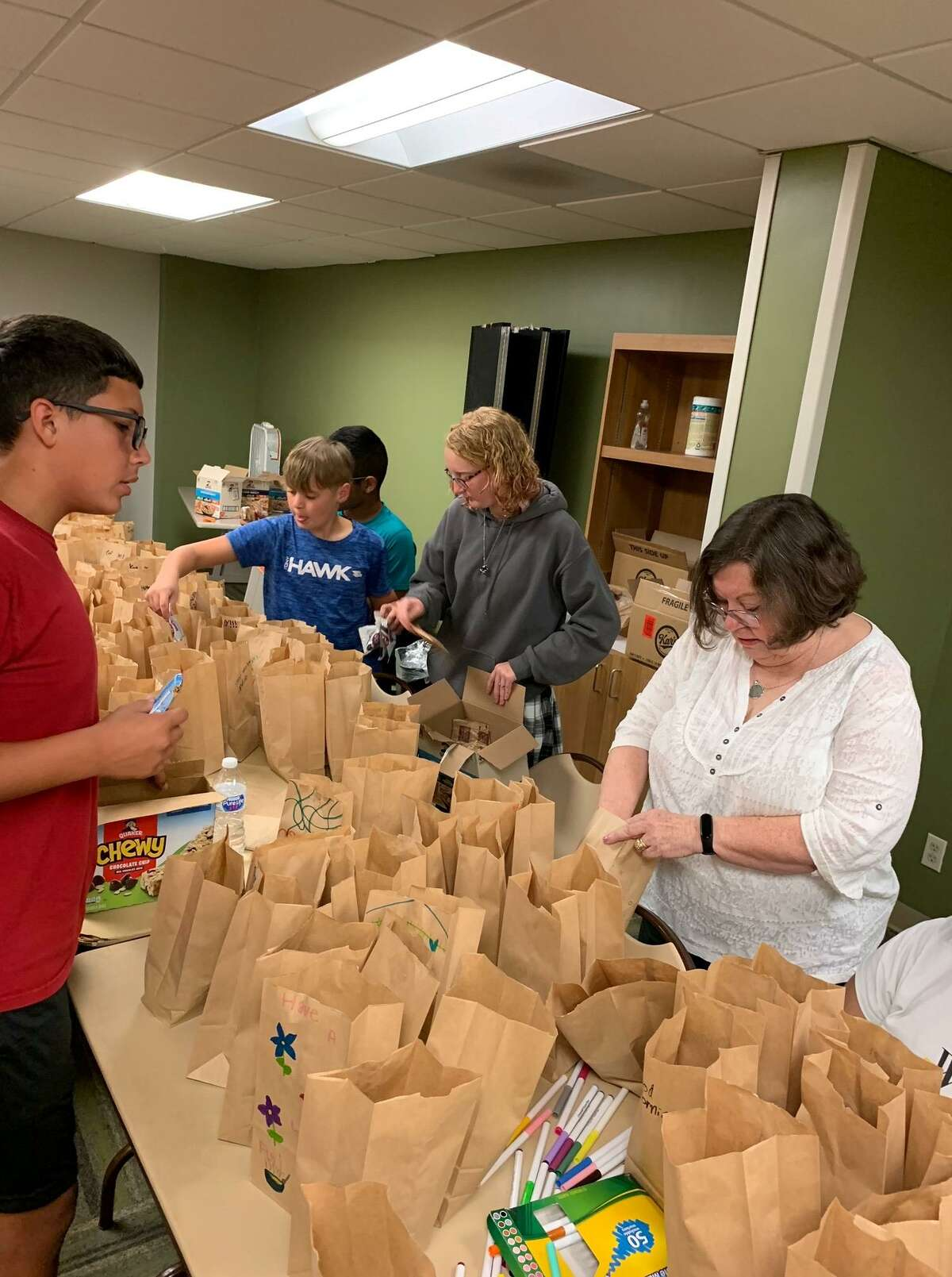 Service-loving teenagers in the Conroe recreation department's teen program decorated 200 bags with colorful drawing and positive phrases on Thursday and filled them with breakfast items for Montgomery County Meals on Wheels.