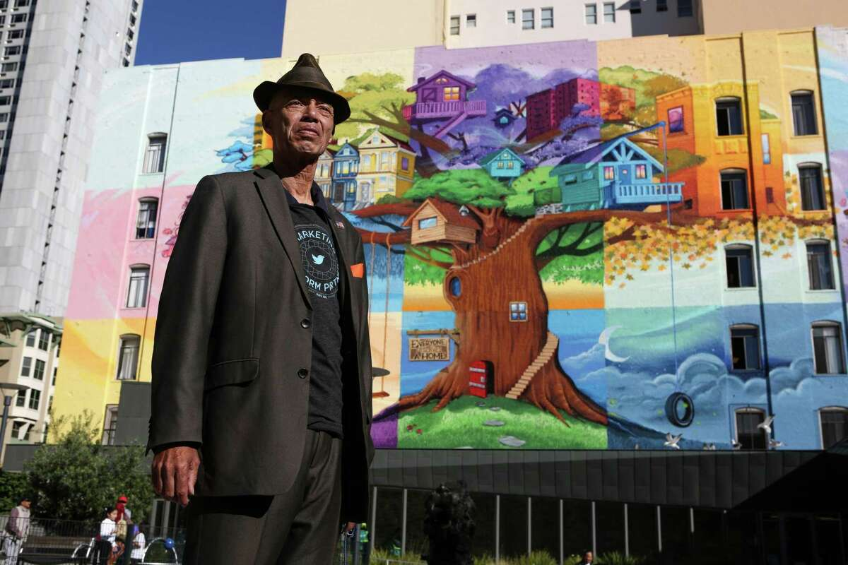 Del Seymour, founder of a job readiness program called Code Tenderloin, stands in front of a mural in the Tenderloin in San Francisco, Calif. Code Tenderloin will offer an eighth of an ounce of cannabis to everyone 21 or older who receive either their first or second jab on site.