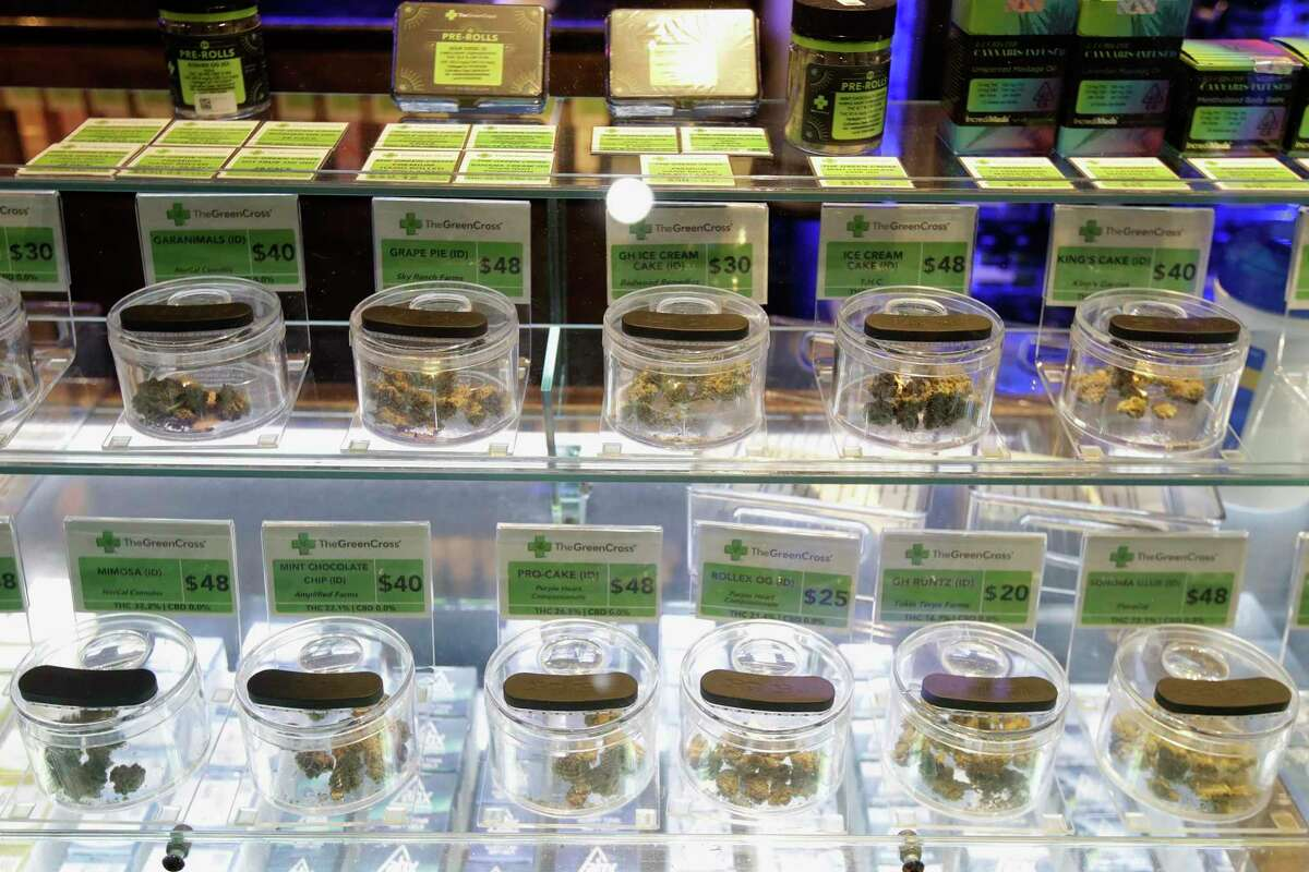Various marijuana buds for sale are displayed at The Green Cross cannabis dispensary in San Francisco. The city is offering free cannabis to adults who receive a first or second shot of a COVID-19 vaccine.