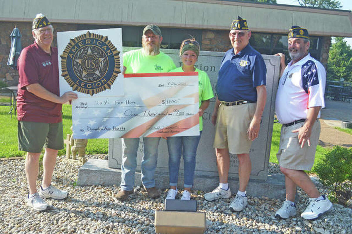 On Monday night, Edwardsville American Legion Post 199 presented a $1,000 check to 2x4's for Hope. Left to right, Larry Miller; sergeant-at-arms for Post 199; Charles Knapp and Jamie Waller from 2x4's for Hope, Ron Swaim, senior vice commander and incoming commander for Post 199; and Wes Sterling, junior vice commander for Post 199.