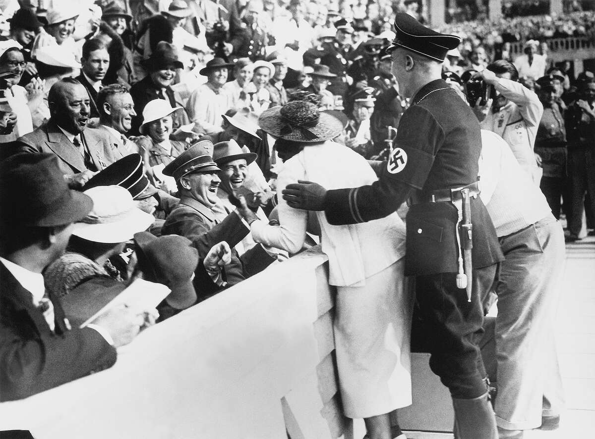 Adolf Hitler attends the Olympic Games in 1936.