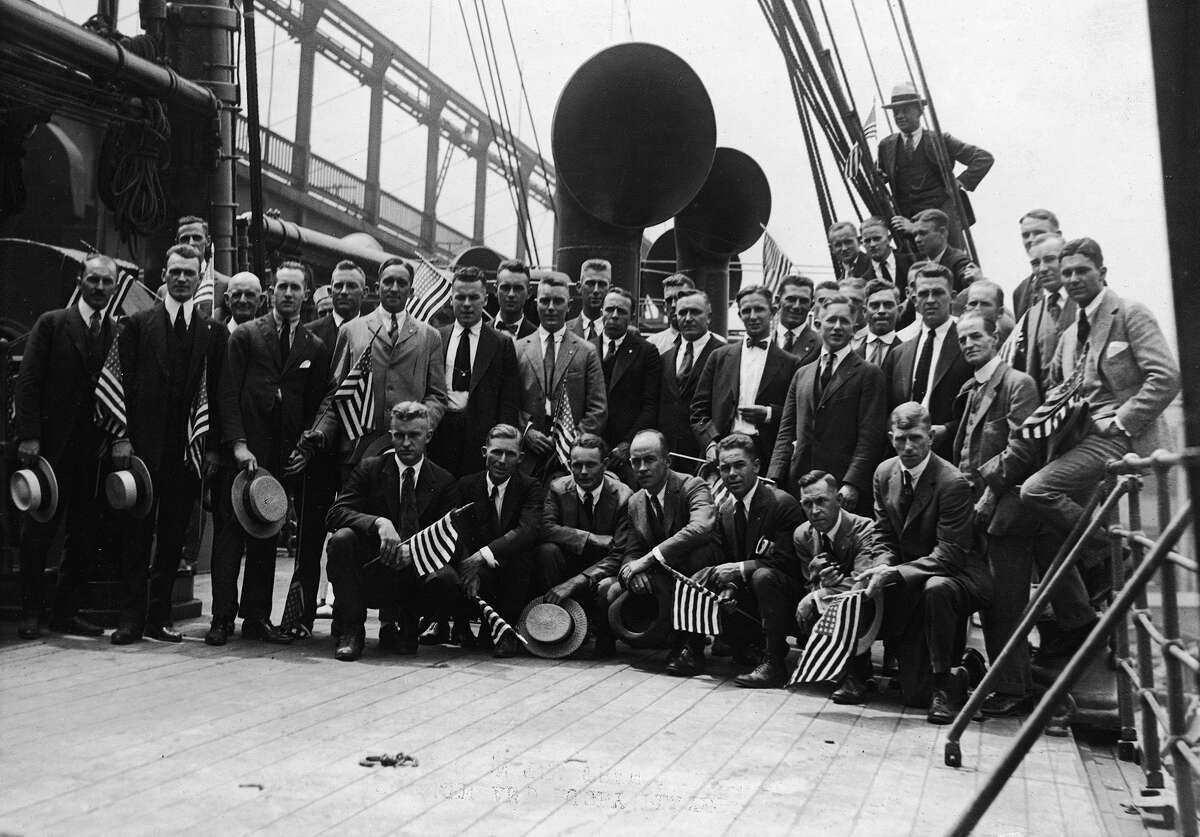 Members of the American Olympics team on the transport ship Sherman pass under a bridge as they set sail to Belgium in 1920. Among the athletes were 20 members of the rugby team, members of the gymnastics team and two scullers.