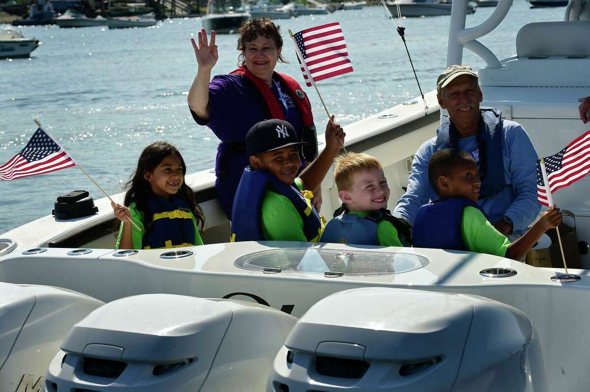 Campers from ROSCCO (Rogers School Community Center Organization) summer vacation program enjoy the water during the Noroton Yacht Club's 25th annual Boat/Camp Friday July 30, 2021, at the Yacht Club in Darien, Conn. Person-to-Person, Darien Boat Club, Darien Police Marine Unit, Noroton Fire Department, Norwalk Seaport Association, United States Coast Guard Auxiliary--Norwalk Flotilla 72 and Darien Sail and Power Squadron partner to provide a safe on-the-water experience for underserved children.