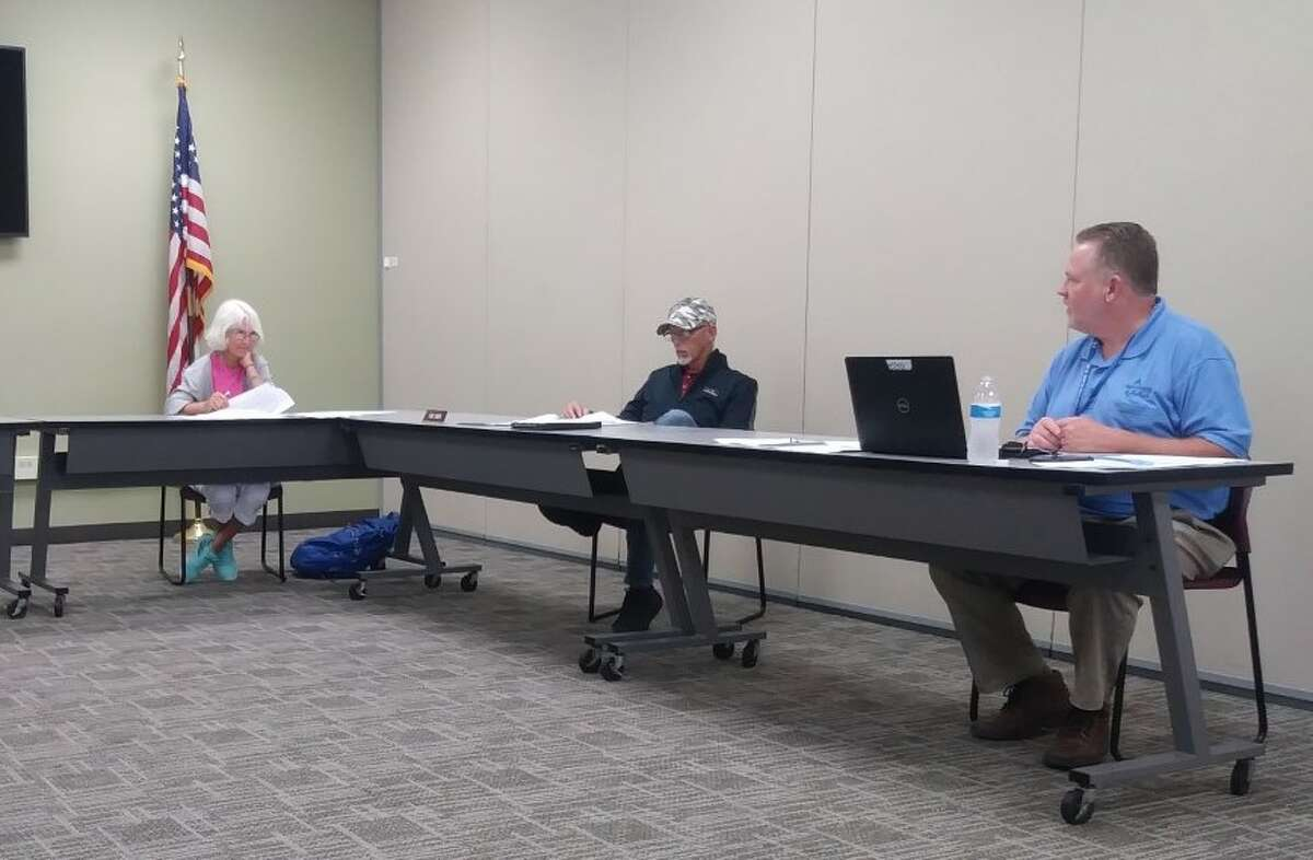 Manistee Intermediate School District superintendent David Cox (right), reflects on a challenging 2020-21 school year during a school board meeting on July 20.