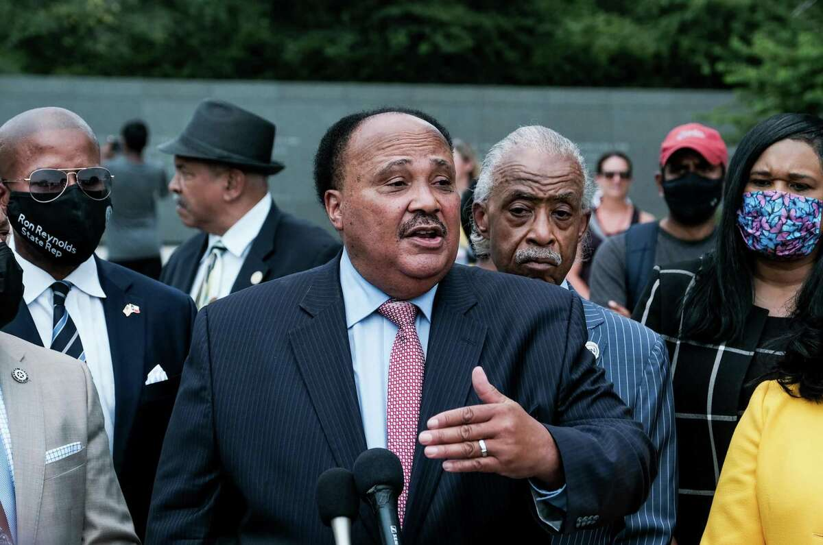 Martin Luther King III, center, speaks during a press conference with members of the Texas State Democratic Delegation at the Martin Luther King, Jr. Memorial in Washington, on Wednesday, July 28, 2021. (Michael A. McCoy/The New York Times)
