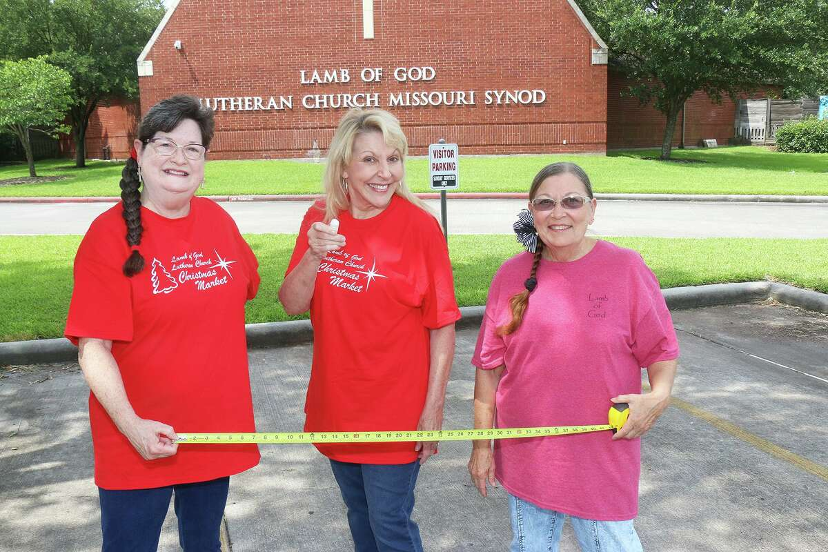 Claudia Lamascus (middle) is joined by her friends Robin Spear and Dynie Bohack as they prepare early for the annual Christmas Market at Lamb of God Lutheran Church in Humble. Last year the event was cancelled because of the COVID-19 pandemic.