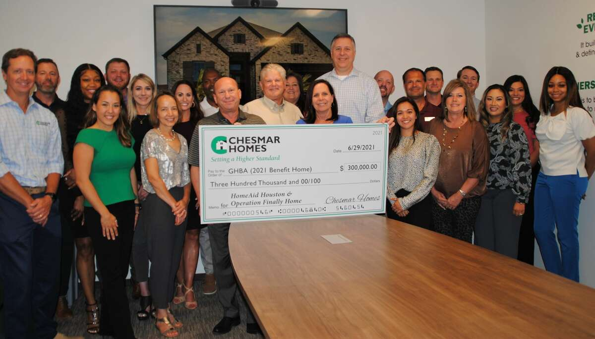 Chesmar Homes' south area sales division presented a check for $300,000 to the GHBA charities.