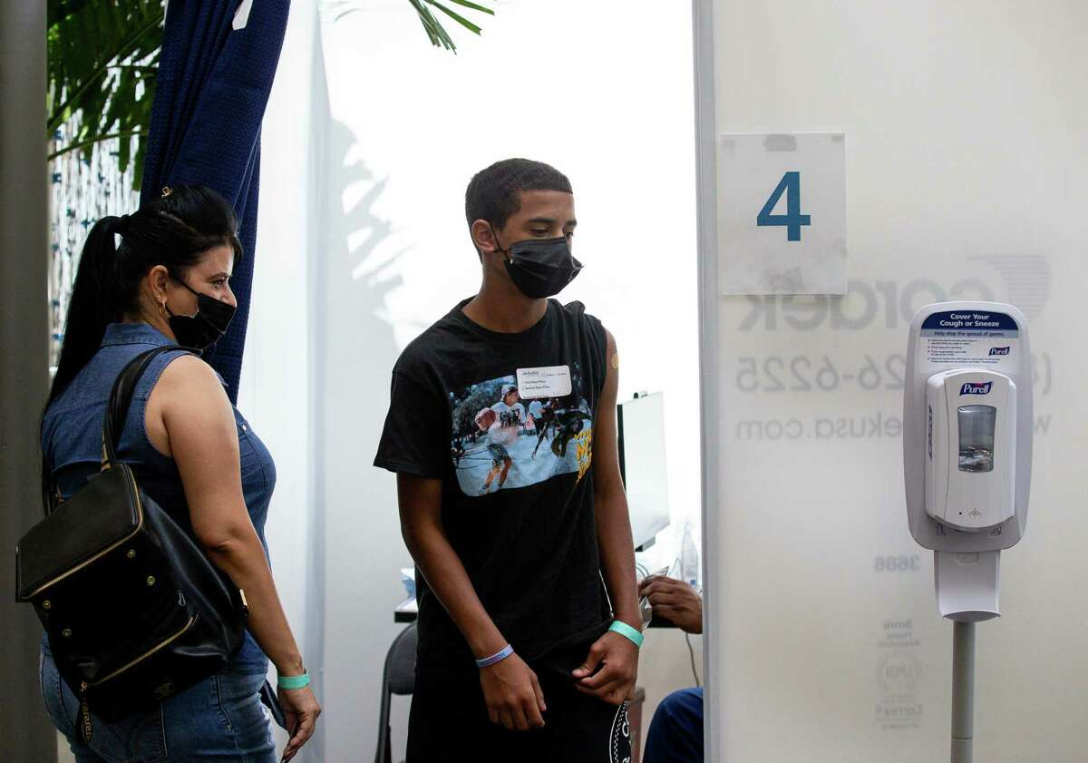 Dianelys Gonzalez, left, watches as her son, Benny Lopez, exits a vaccination room where he received a COVID-19 vaccine at Houston Methodist West Hospital on Wednesday, July 28, 2021, in Katy.