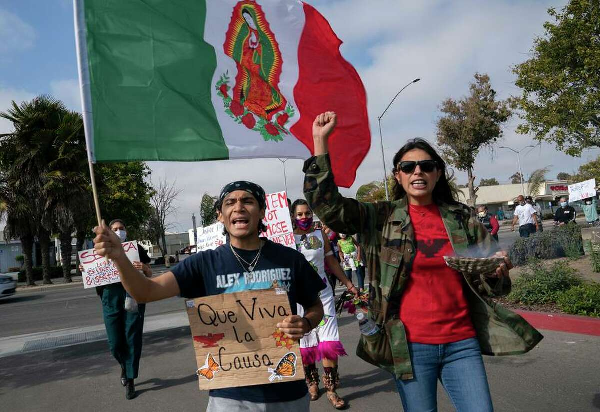 From right, Samantha Varela of the Monterey County Solidarity Coalition (MCSC83) and Max Lopez lead supporters into the parking lot of the Salinas Police Department during a rally for Gerardo Chavez Martinez on Saturday, July 24, 2021 in Salinas, Calif. Salinas police shot and killed 19-year-old Martinez in the doorway of his house. He had a BB gun and neighbors told the cops that he did not speak Spanish, he spoke Zapotec.