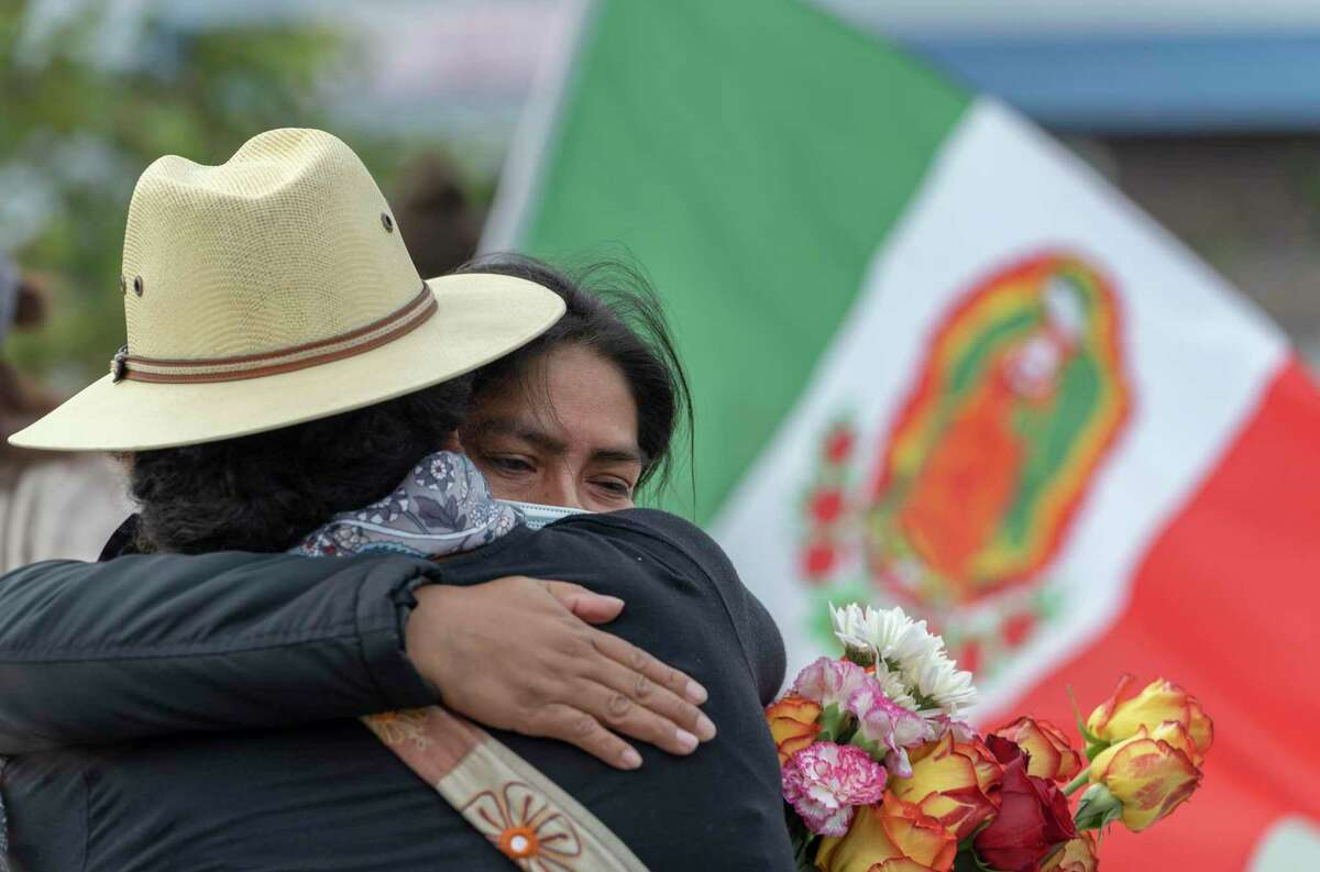 At center, Paulina Martinez Chavez, mother of Gerardo Chavez Martinez, hugs a supporter during a rally in support of her family in front of the Salinas Police Department on Saturday, July 24, 2021 in Salinas, Calif.