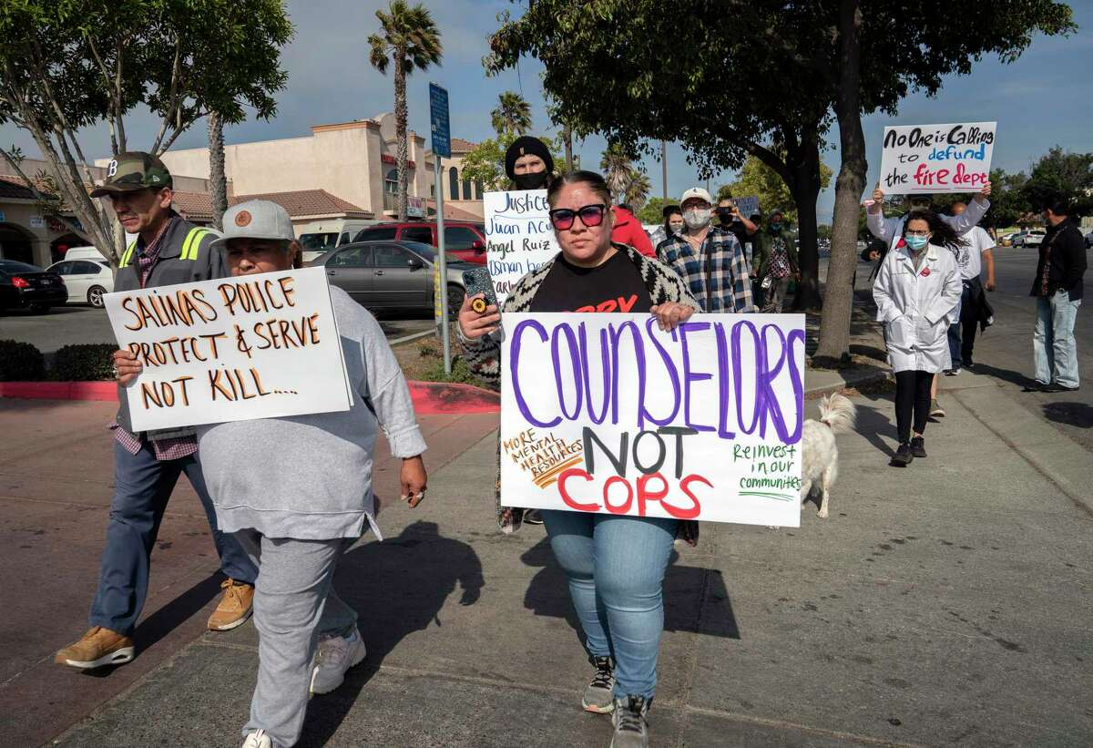 Community members and supporters rally for Gerardo Chavez Martinez as they head toward the Salinas Police Department on Saturday, July 24, 2021 in Salinas, Calif.