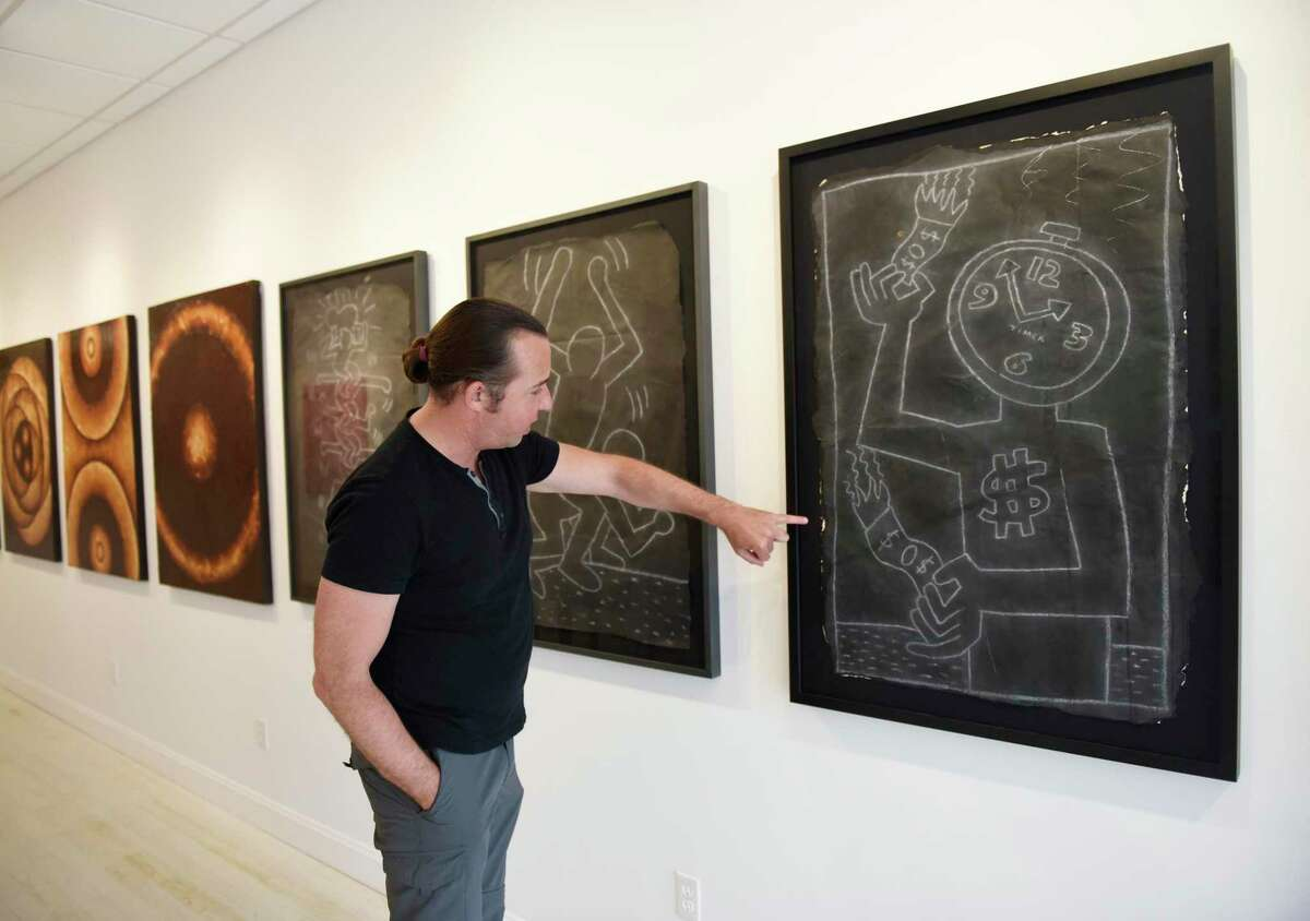 Managing Director and Co-Owner Alex Trimper shows chalk drawings from renowned artist Keith Haring recovered from New York City Subway stations in the 1980s at Isabella Garrucho Fine Art in Greenwich, Conn. Thursday, July 29, 2021.