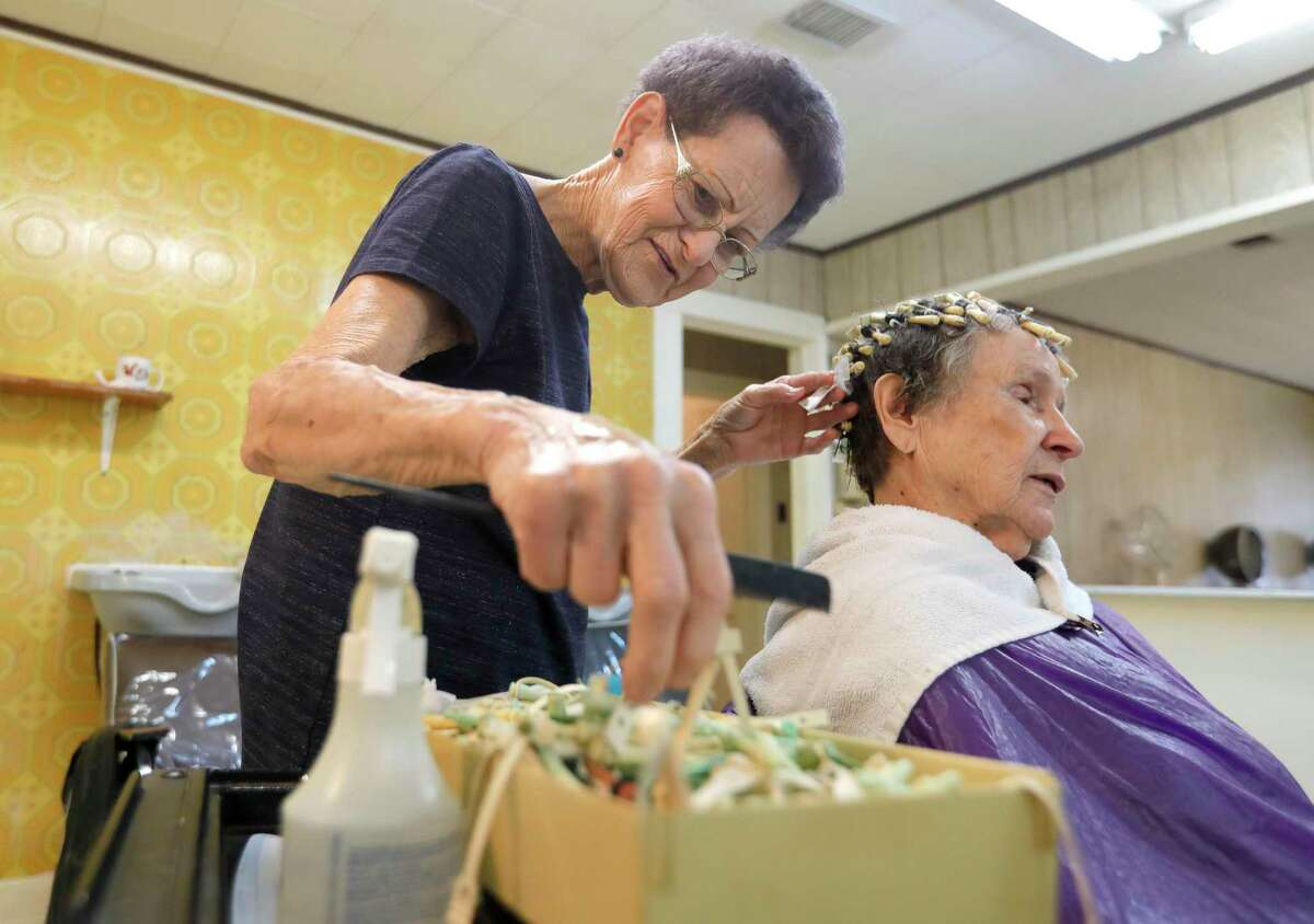 Jimmie Wood Stearns, 79, works on curling the hair of long-time client Jo Fergson at Trudy's Beauty Salon, Tuesday, July 27, 2021, in Conroe. Stearns, who has been doing hair in Conroe since 1962, will retire on Friday.