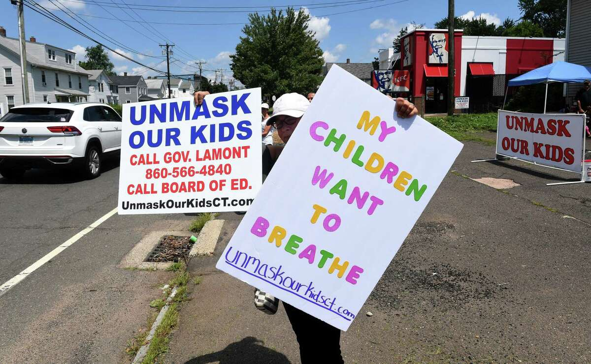 Sabrina Parent of Middletown participates in a rally on South Main Street in Middletown on July 30, 2021 against requiring children to wear masks in school.