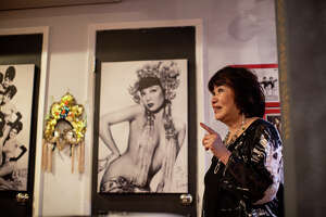 Cynthia Yee, a former dancer and Miss Chinatown 1967 gives a tour around the Showgirl Magic Museum in San Francisco, Calif. on July 29, 2021. The museum is a tribute to San Francisco's rich mid-20th century nightclub culture.
